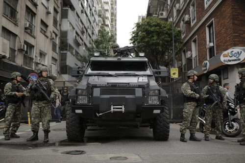 Border police officers block a street in the city ahead of the G20.