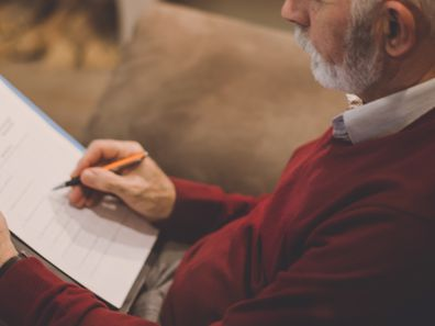 Older man writing his will