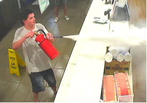 The man fired the extinguisher in the direction of staff members in the kitchen area.