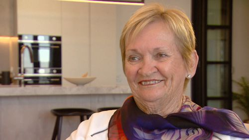 Moya McGirr lives in a new high-rise retirement home, which she says keeps her young.