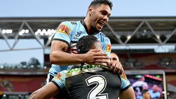 Sione Katoa of the Sharks is congratulated by team mates after scoring a try during the round 24 NRL match between the Cronulla Sharks and the Brisbane Broncos at Suncorp Stadium, on August 28, 2021, in Brisbane, Australia. (Photo by Bradley Kanaris/Getty Images)