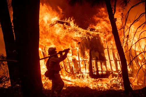 A massive new federal report warns that extreme weather disasters like California's wildfires and this year's hurricanes are worsening in the United States.