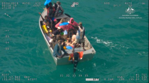 There were fifteen people - including five children - on board the 4.4 metre dinghy. Picture: AMSA