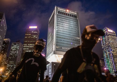 Protesters walk in front of the People's Liberation Army Barracks after a school boycott rally in Central district on September 2, 2019 in Hong Kong. Pro-democracy protesters have continued demonstrations across Hong Kong since 9 June against a controversial bill which allows extraditions to mainland China.