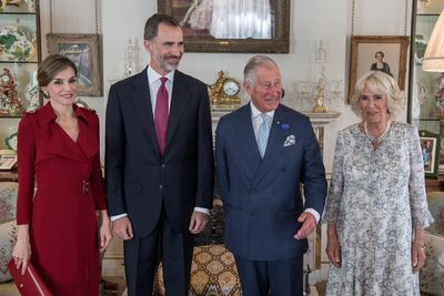 <p>For her first official meeting  with Prince Charles and The Duchess of Cornwell at Buckingham Palace  Queen Letizia made &nbsp;a politically appropriate fashion statement with a dark red trench dress from British heritage brand Burberry.</p> <p>The Spanish royal paired the dress with a pair of patent leather pumps from Prada and a coordinating clutch by  Spanish leather goods brand Menbur. </p>