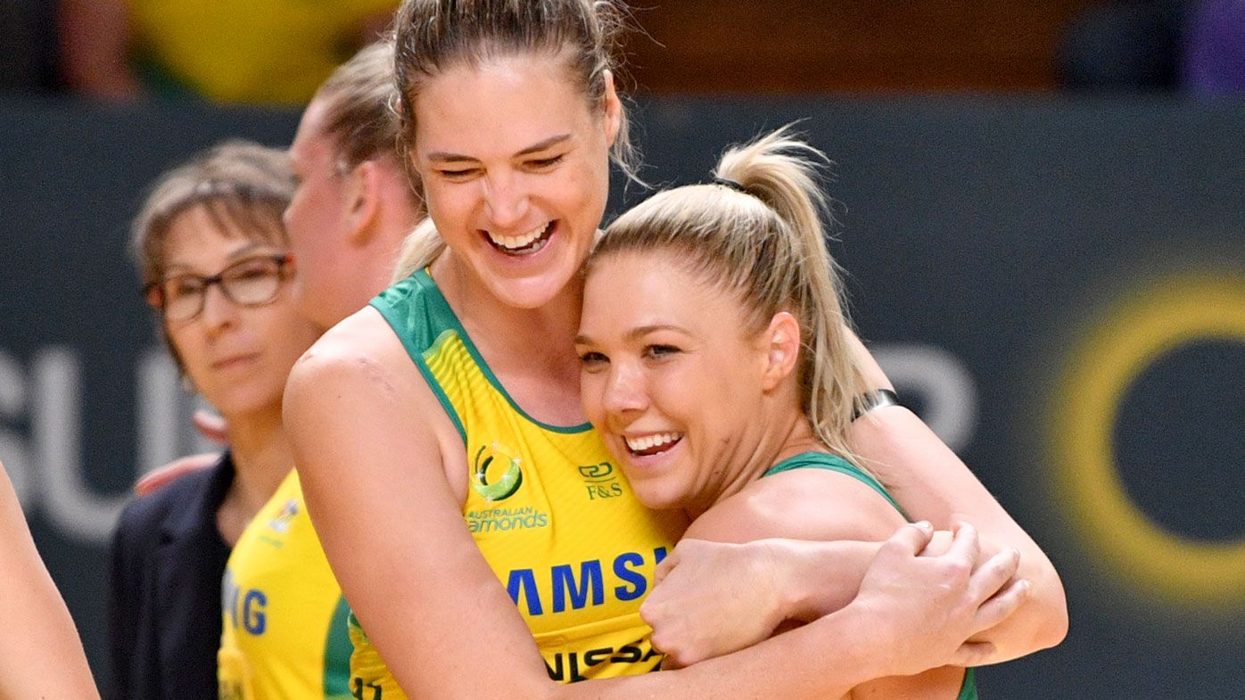 Kate Moloney and Caitlin Bassett celebrate victory in the Constellation Cup over the New Zealand Silver Ferns. (AAP)