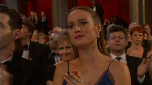 Brie Larson applauds Gaga's performance.
