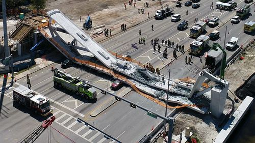 The death toll from a pedestrian bridge collapse in the outskirts of Miami, Florida yesterday has reached six, although authorities believe that number could rise as the rubble is removed (AAP).