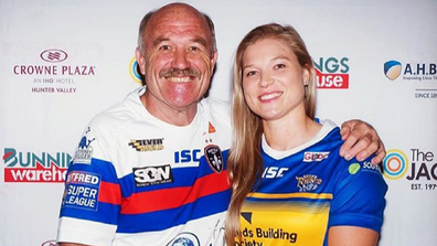 Wally Lewis with his daughter Jamie-Lee who is profoundly deaf.