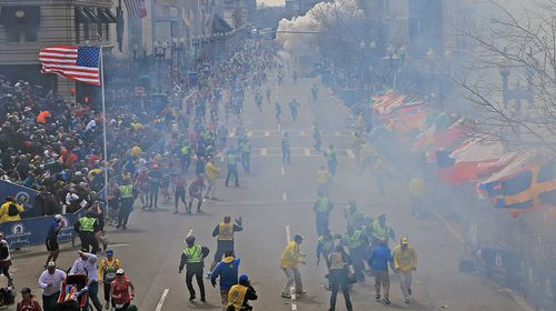 Smoke fills the street after a second explosion went off near the finish line of the Boston Marathon. (Getty)