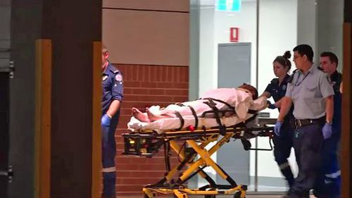 One man is wheeled into St George Hospital following the incident.