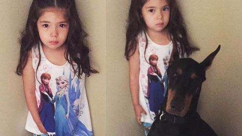 Buddah won't leave Siena's side even when she is given a time-out by her mother. (Facebook)
