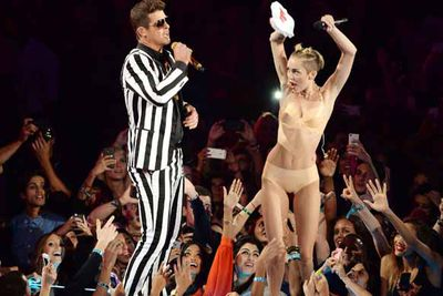 """It was the moment we all went """"WTF"""" as Miley Cyrus donned PVC underwear and twerked all over Robin Thicke. Oh and there were the human-sized teddy bears, a lot of tongue poking and let's try to forget about the suggestive foam hand movements. The world was never the same again…"""