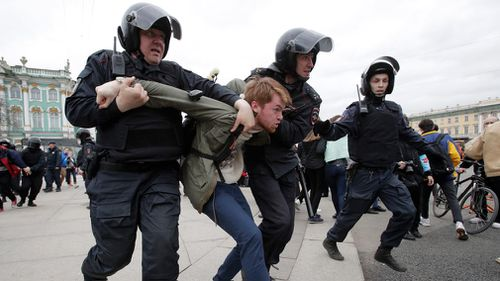 Russian police detain a protester at a demonstration against President Vladimir Putin in St Petersburg, Russia. (AP)