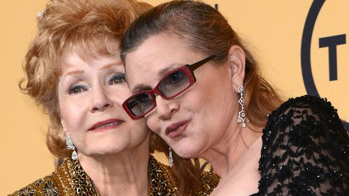 Carrie Fisher with her mother, movie star Debbie Reynolds. (AAP)