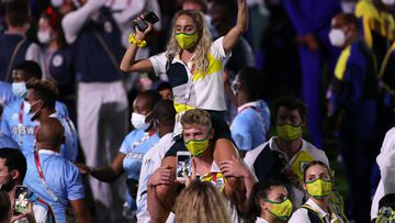 Ash Moloney shoulders his teammates around the Olympic Stadium during the closing ceremony.