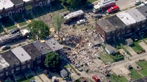 Baltimore gas explosion destroys three homes, killing at least one person and trapping another