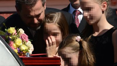 May 11, 2012: Gerard hugs mourners and comforts his daughters at Allison's funeral.