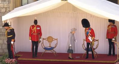 The Queen chats to the Duke of Kent at the conclusion of the ceremony.