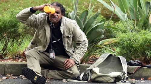 A man washes capsicum spray out of his eyes. (AAP)