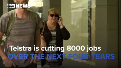 Telstra cuts executive bonuses, says sorry