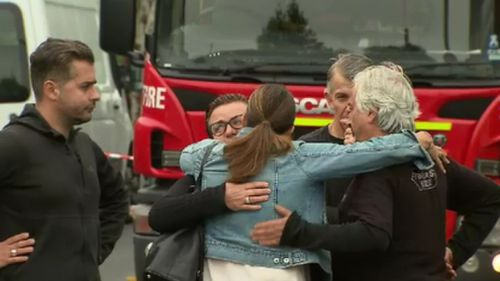 The Pentaris family supported each other at the scene of the fire this morning.