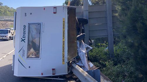 An elderly couple's caravan crashed on the M1 in Sydney this morning.