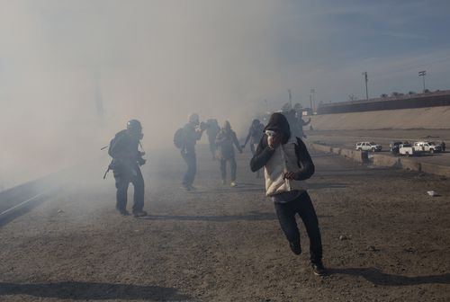 Border guards were forced to use potent teargas on the migrants attempting to cross the border after a treacherous two week journey.