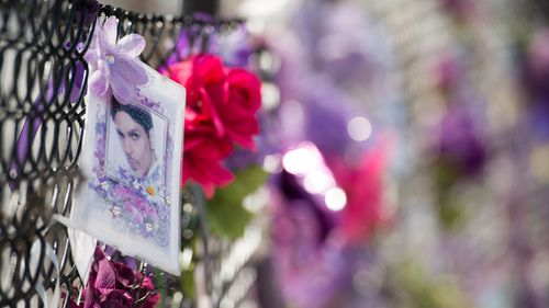 Fans of US musician Prince still leave notes and flowers on a fence outside of Paisley Park, Princes' home and where he was found dead after an overdose in two years ago Chanhassen, Minnesota. (EPA)