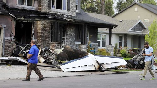 Federal Aviation Administration officials investigate the scene of a plane crash in Payson, Utah. (AAP)