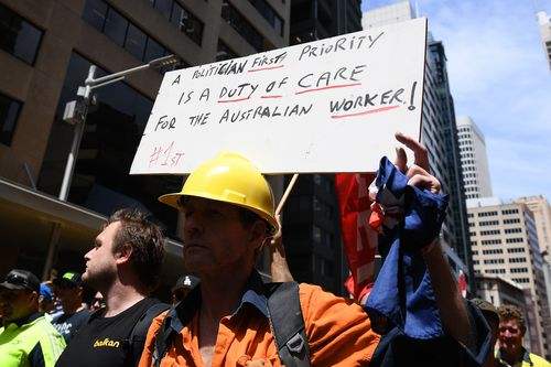 "Protesters have accused the PM of taking workers on a ""highway to hell."""