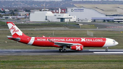 Passengers terrified after AirAsia plane stops with 'loud bang' on tarmac