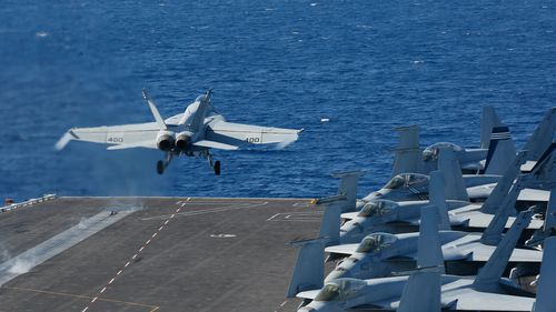 F/A-18E Super Hornet from VFA 25 launches from the flight deck of the Nimitz-class aircraft carrier USS Abraham Lincoln.