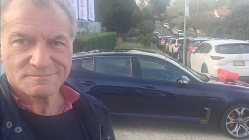 Victor took a selfie with his new car - and found out later he'd been hit with the parking fine.