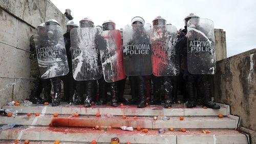 Greek police say 'at least' 25 officer were injured in the protests.