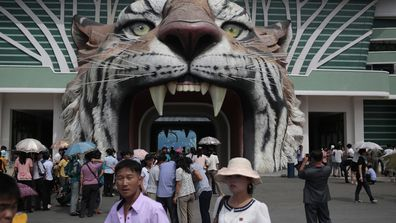 North Korean leader Kim Jong Un's latest gift to Pyongyang, the renovated central zoo, is pulling in thousands of visitors a day with typical zoo fare as elephants, giraffes, penguins and monkeys.But one of the most popular attractions might come as a surprise to foreign visitors. (AAP)