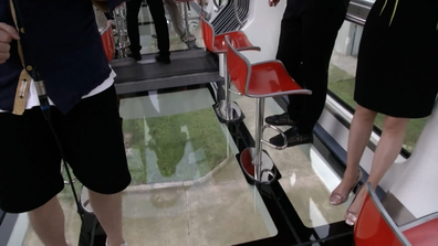 The cars on Chengdu's new Zhongtang Air Railway have glass floors
