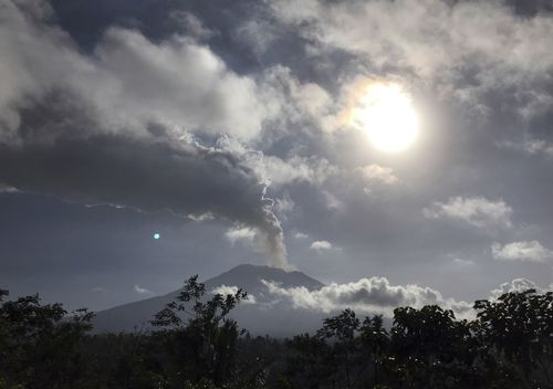 The eruption sprayed ash more than two kilometres into the air, affecting travel into and out of Bali. Picture: AAP.