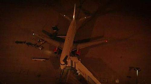 The process began with Corby switching flights from Bali at the last moment and rushed through Brisbane Airport while other passengers were held back. Picture: 9NEWS.