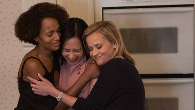 Mia (Kerry Washington), Writer Celeste Ng and Elena (Reese Witherspoon) shown on the set of Little Fires Everywhere. (Photo by: Erin Simkin/Hulu)