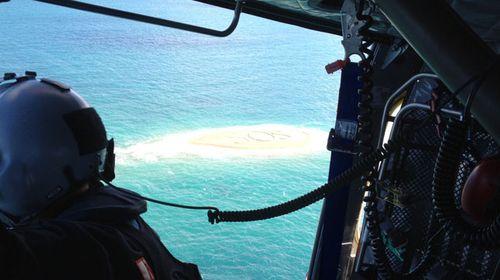 Giant SOS saves stranded boaties in Queensland