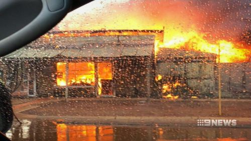 Powerlines were felled in the storm, sparking a fire. (9NEWS)
