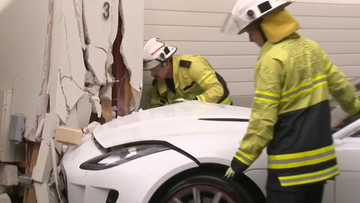 Man crashes luxury Jaguar into front of neighbour's home