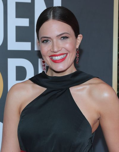 <p><em>This is Us</em> actress Mandy Moore chose the perfect accompaniment for her black Rosie Assoulin gown, a classic red statement lip. Perfect with any little black dress.</p>