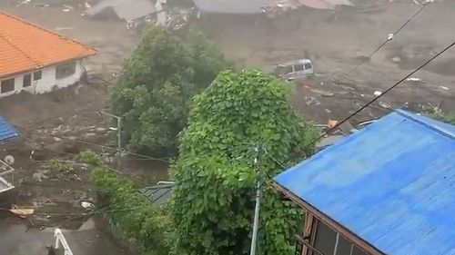 This grab taken from handout video released by a local resident and received via Jiji Press on July 3, 2021 shows mud and debris at the scene of a landslide.