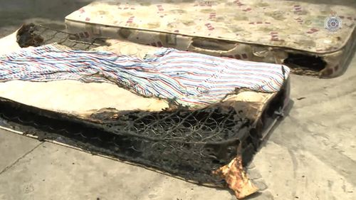 Mattresses from the burning bedroom where police believe two children were deliberately trapped. (Supplied)
