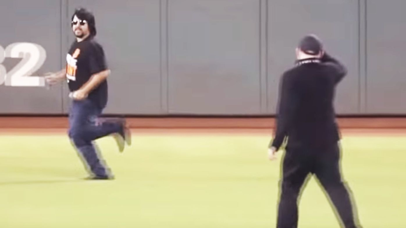 Security breaks leg chasing pitch invader