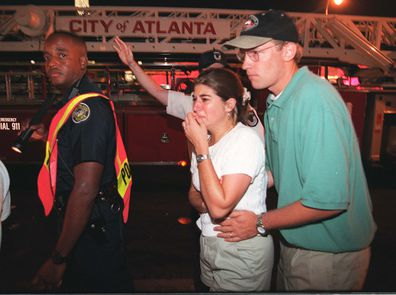 Dazed people wandered in nearby streets after the bomb went off in the early hours of the morning at   Centennial Olympic Park, Atlanta on July 27, 1996.