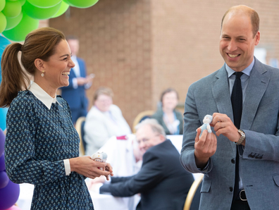 Kate laughed as Prince William spoke to the gathered crowd.
