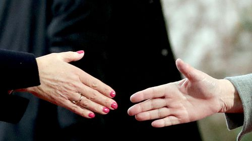 British Prime Minister Theresa May shakes hands with German Chancellor Angela Merkel.